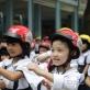 Xử lý nghiêm trường hợp không đội mũ bảo hiểm cho trẻ em khi tham gia giao thông mùa tựu trường