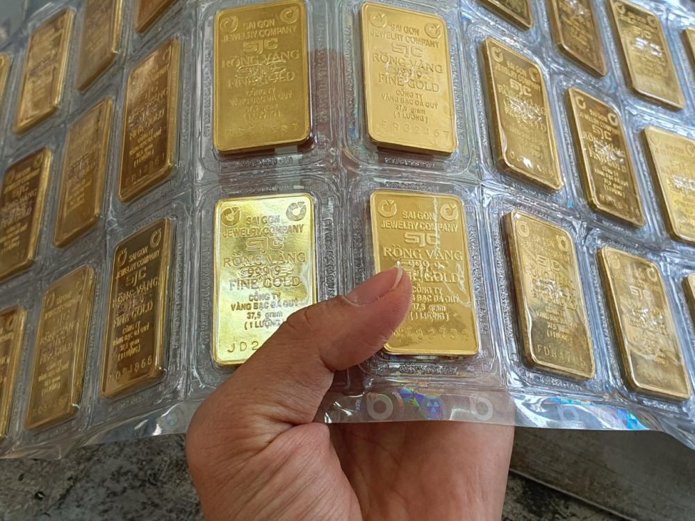 """Bị """"đồng bạc xanh"""" làm lu mờ vàng tiếp tục đi xuống trong tuần tới"""